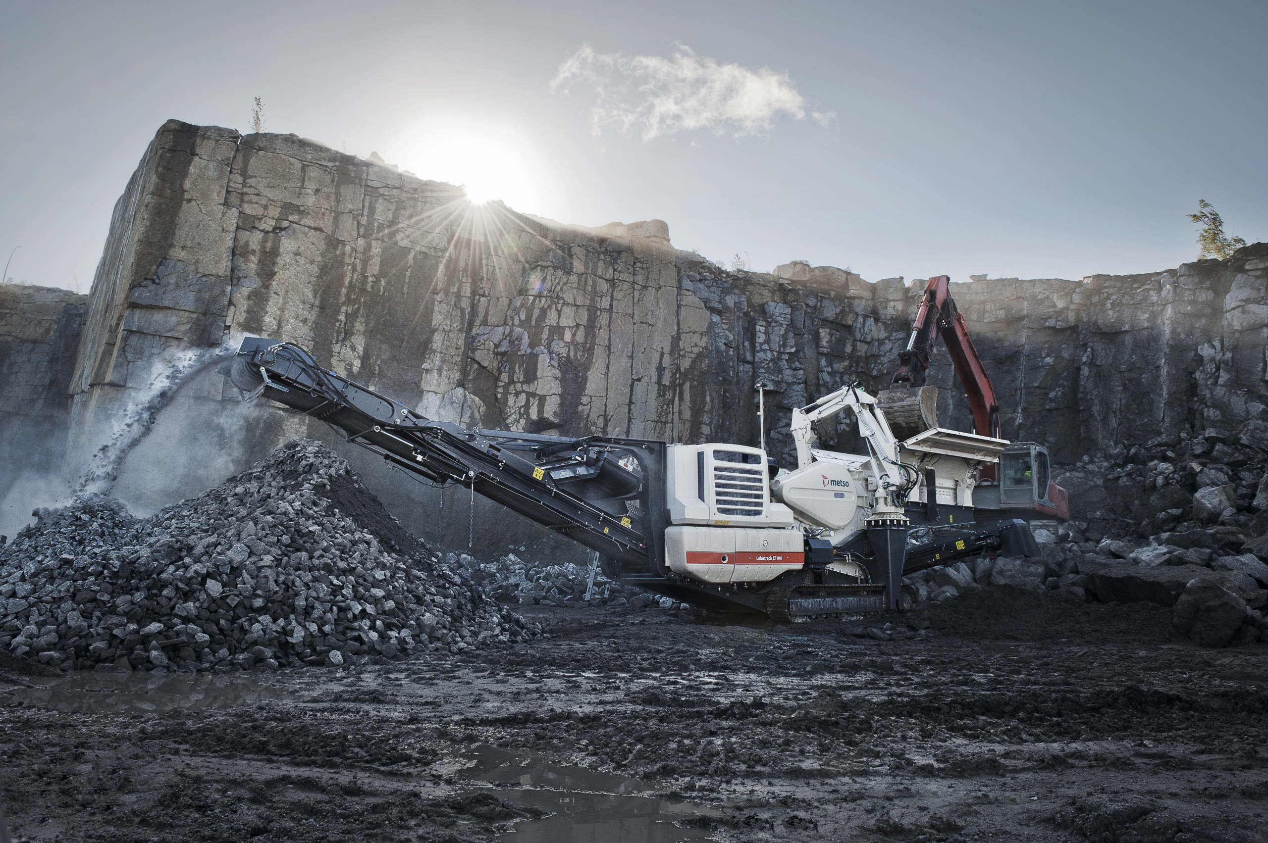 Large Metso excavation vehicles digging in a quarry