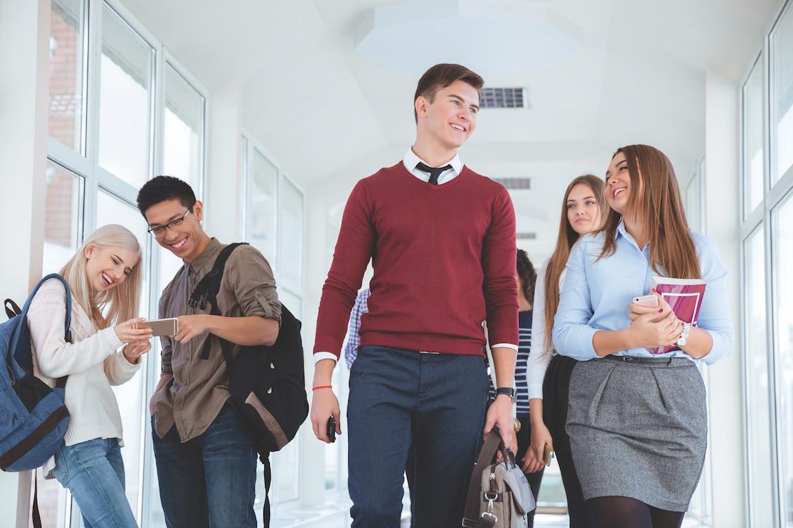 Students walk through hallway of university