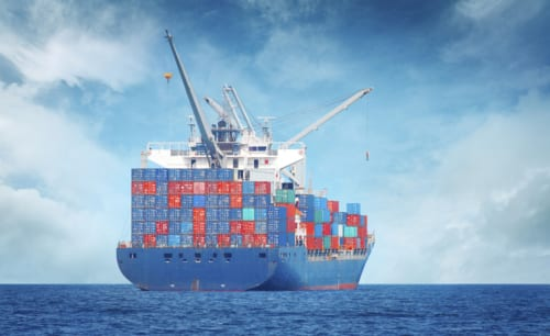 loaded container ship on open ocean