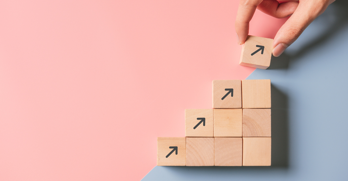 Wooden blocks with arrows representing growth