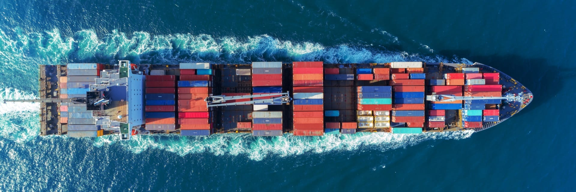 Top view of ocean freight ship with containers