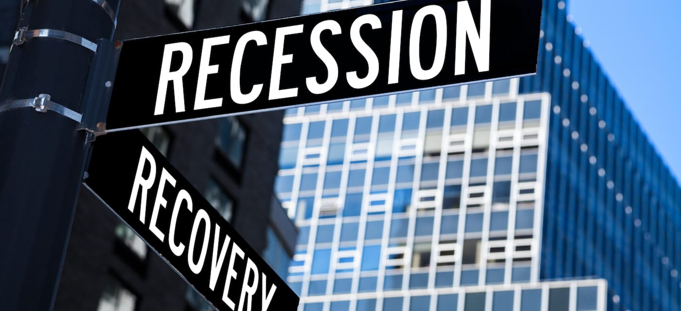 road signs marking recovery from recession